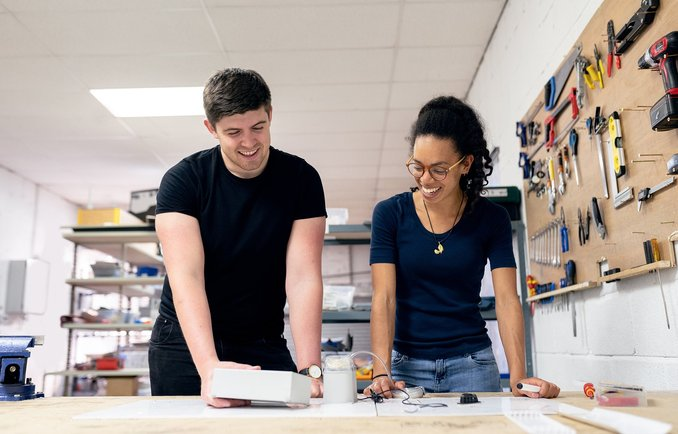 Two young people working in makerspace